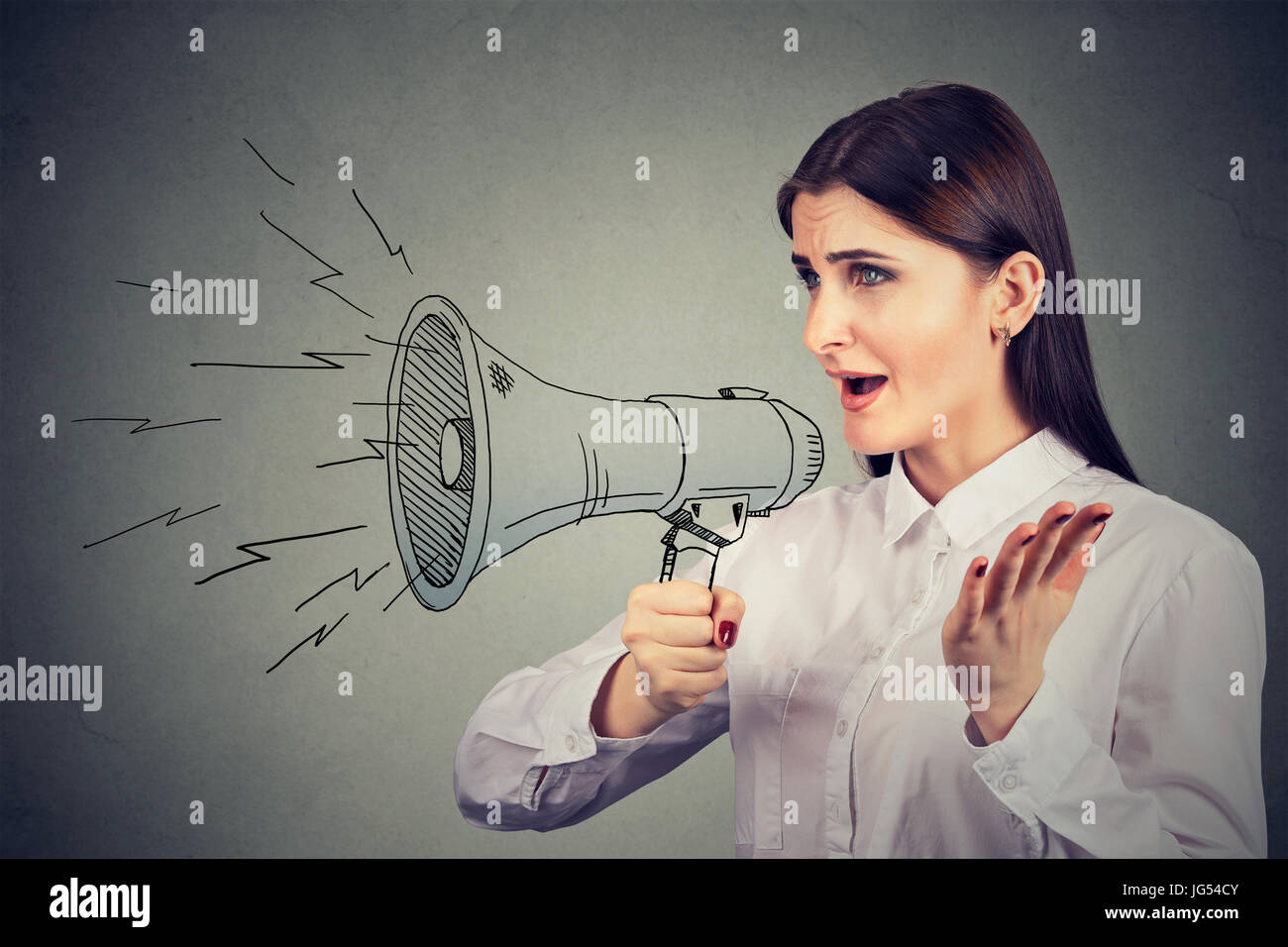 Woman making announcement with megaphone - Stock Image