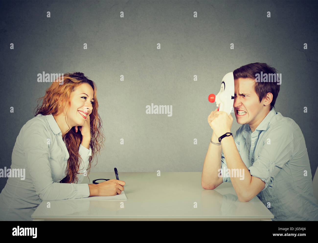 Woman interviewing new candidate for a job, a man pretender hiding his real personality Stock Photo