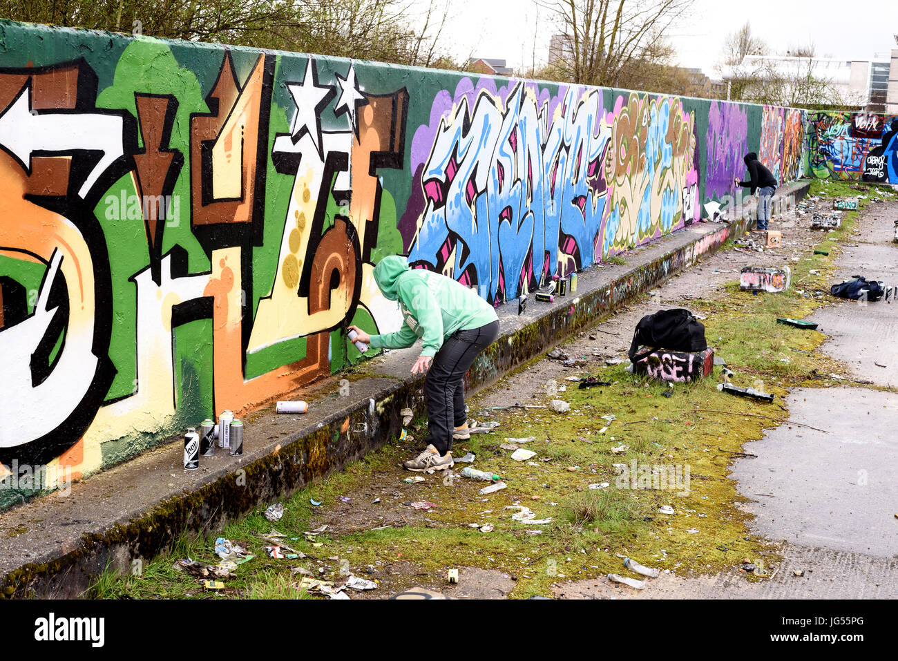 Chelmsford England 22Nd March 2017 Graffiti Artists Working On A Public Wall Spraying Paint To Create Urban Art The Walls Are Free For All To Paint
