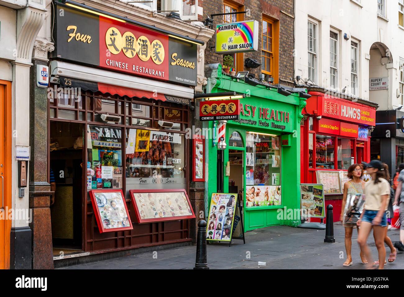 Chinese Restaurants and Shops On Wardour Street, Chinatown, London, UK - Stock Image