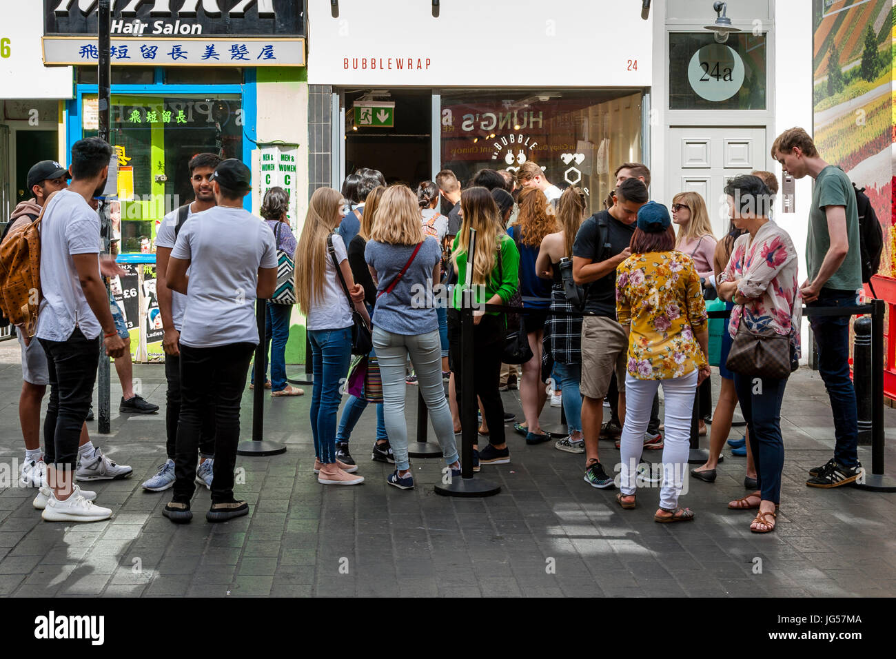 People Queueing Outside The Bubble Wrap Waffle Store, Wardour Street, Chinatown, London, UK Stock Photo