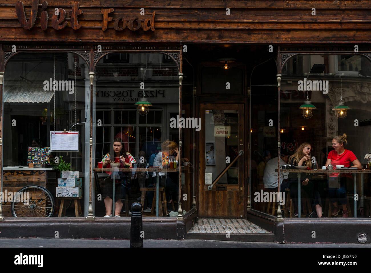 People Eating Vietnamese Food In The Viet Food Restaurant, Wardour Street, London, UK - Stock Image