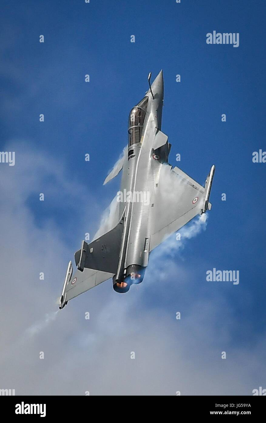 A French Dassault Rafale fighter aircraft performs aerial maneuvers during the Paris Air Show at the Paris-Le Bourget - Stock Image