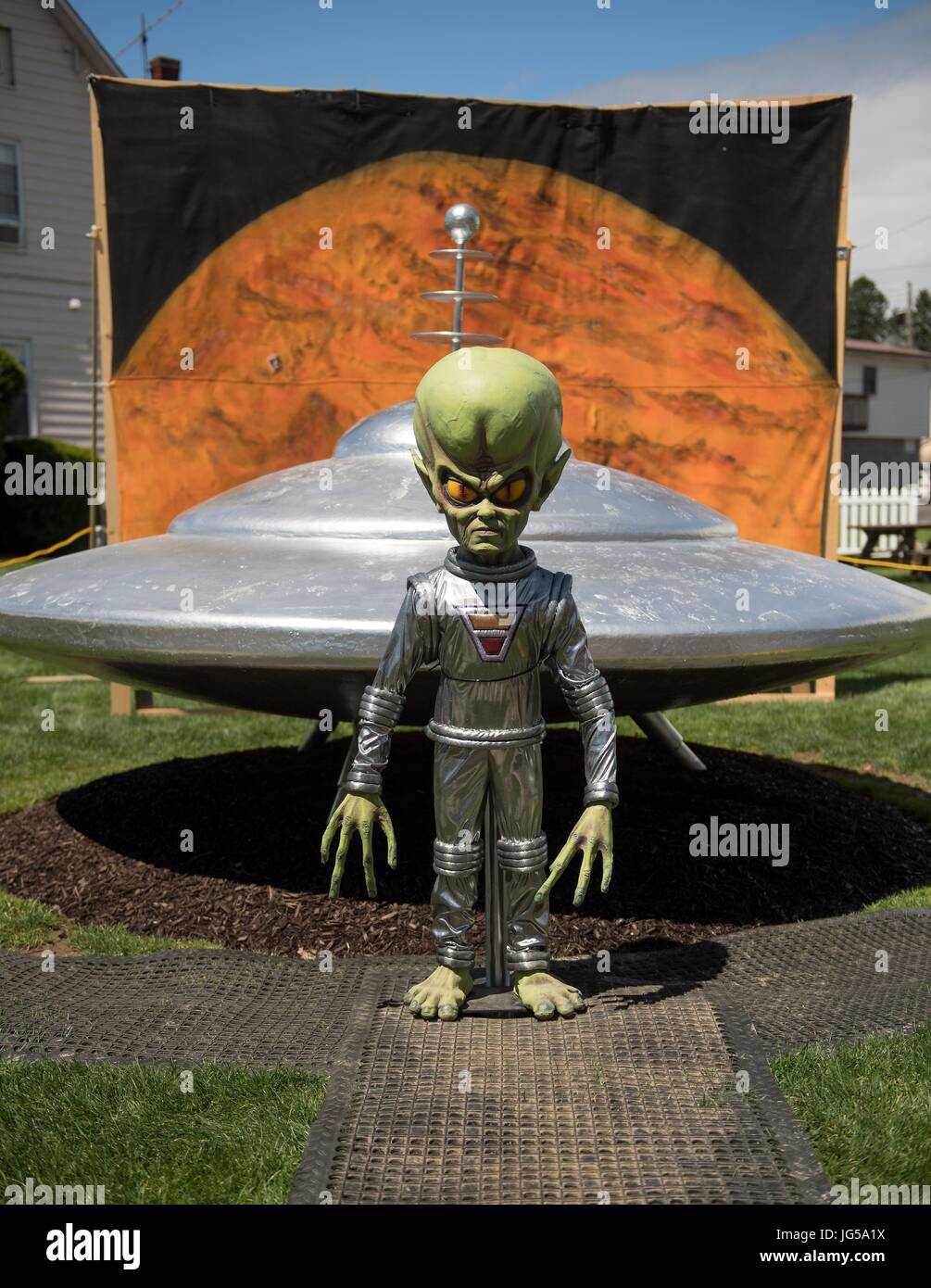 An alien statue and sculpture of a UFO is set up for the Mars New Years Celebration May 5, 2017 in Mars, Pennsylvania. - Stock Image