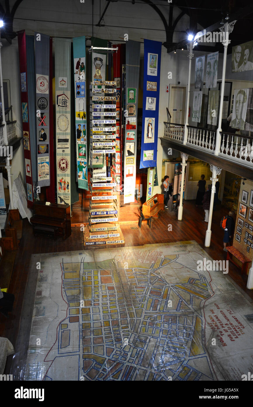Main floor of the District Six Museum has a neighborhood floor map and other artifacts before residents were forcibly - Stock Image