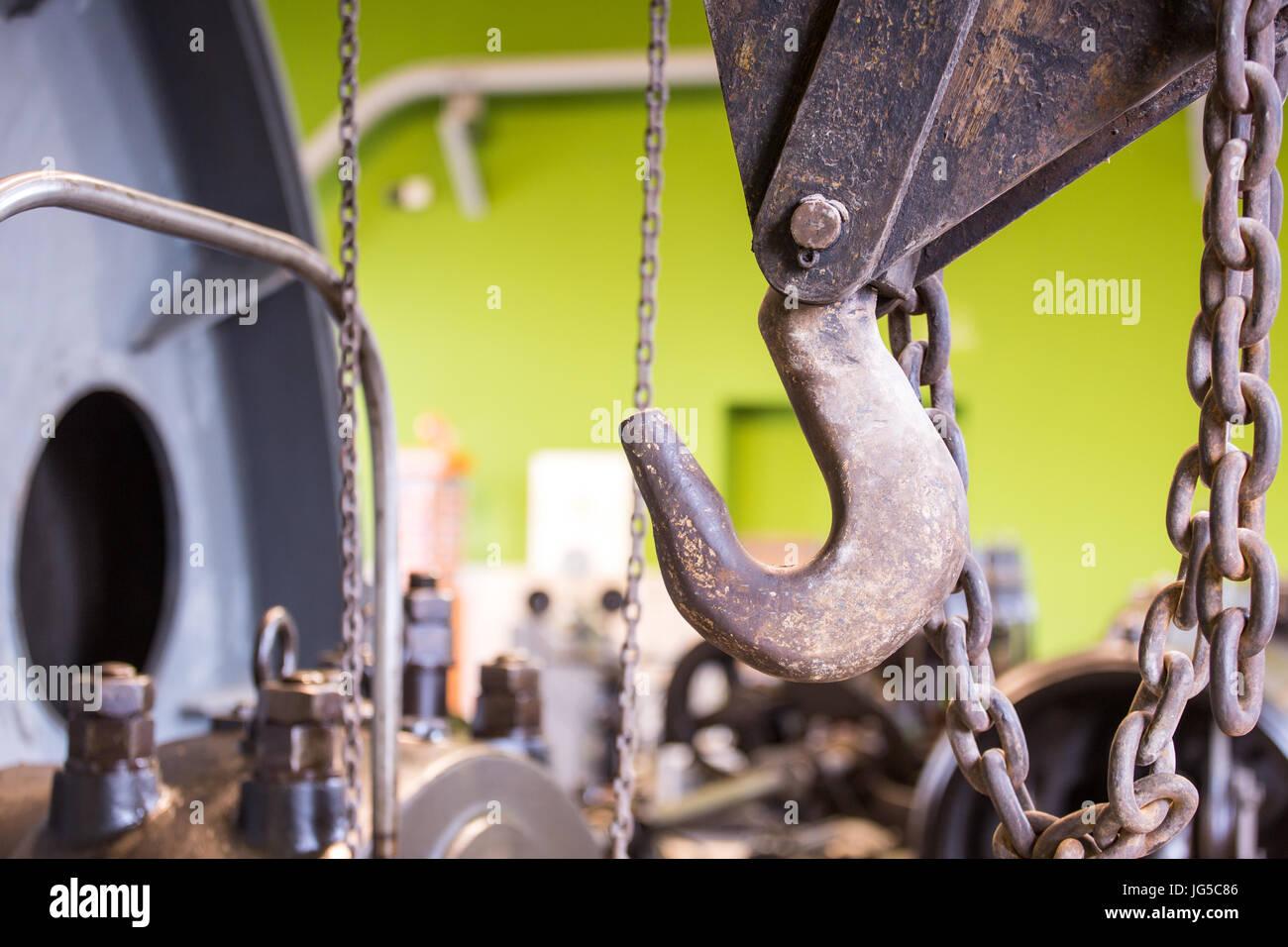 Vintage mining winch empowered by steam engine. Hook. Stock Photo