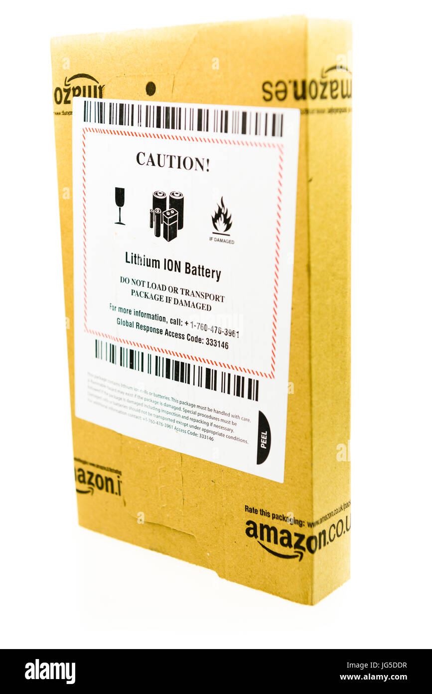 Package from Amazon with a  sticker warning that the package contains a Lithium Ion battery, and not to transport - Stock Image