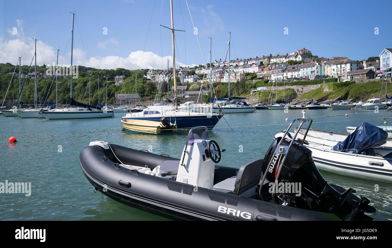 Yachts anchored in the safe haven of New Quay harbour, Ceredigion, Wales, UK - Stock Image