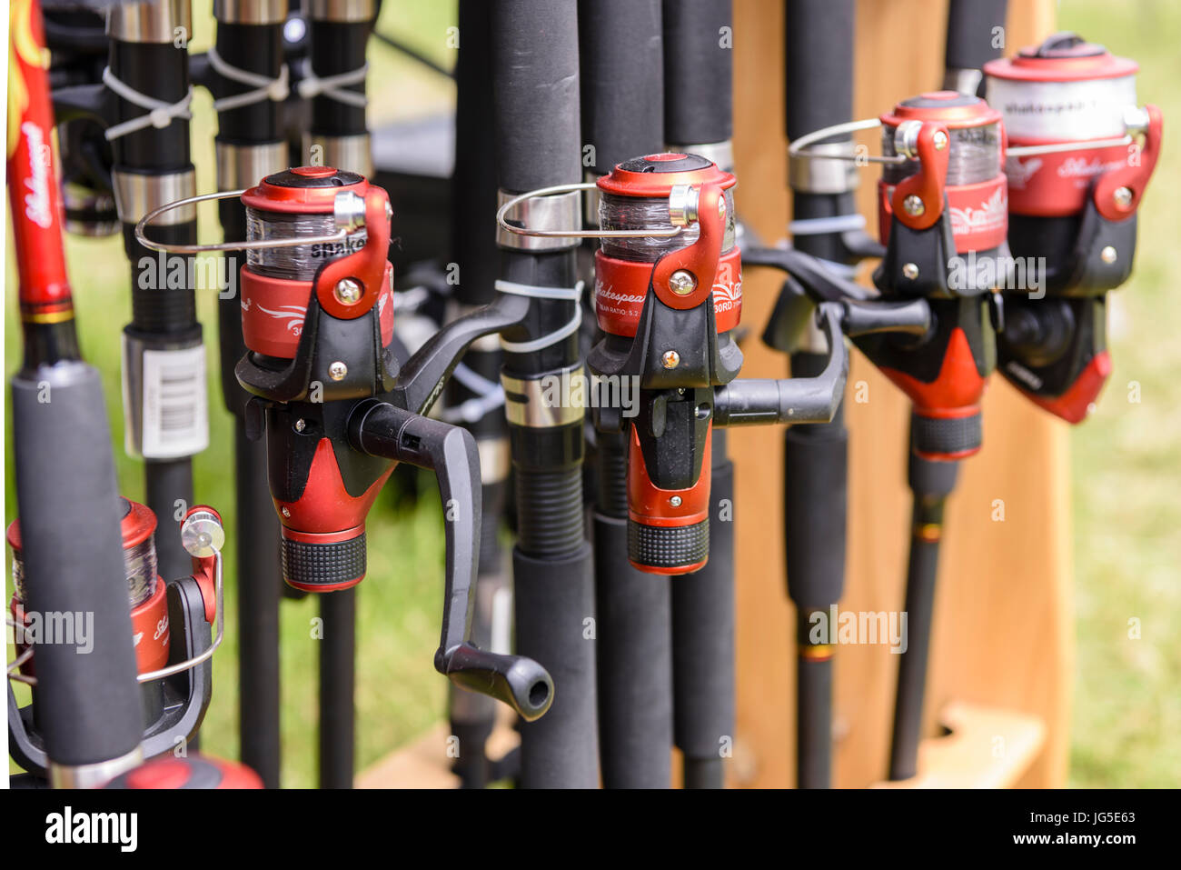 Fishing spinning rods and reels for sale at a market stall Stock ...