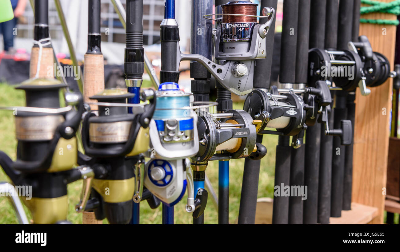 Sea fishing rods and reels for sale at a market stall Stock Photo ...