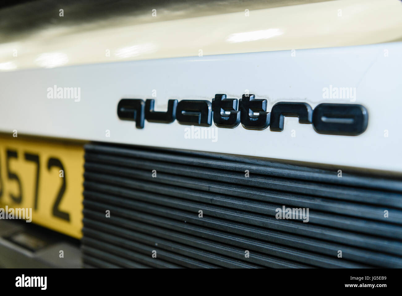 Badge on the boot trunk of an Audi Quattro 4x4 four all wheel drive sports performance car - Stock Image