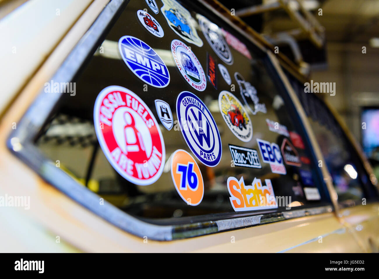Very old volkswagen with various car stickers on the rear window from the 1970s stock