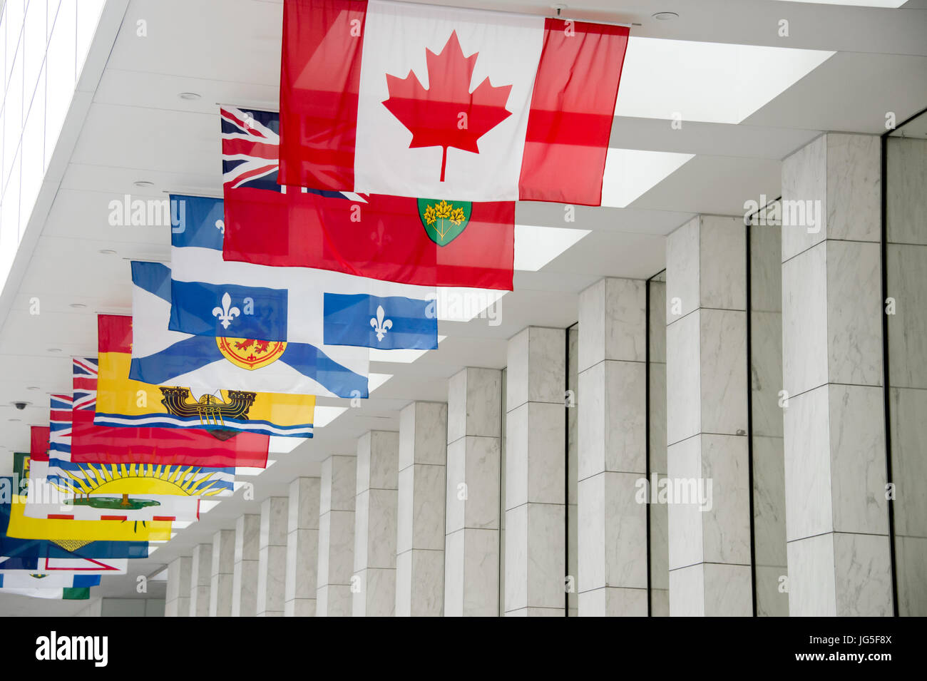 Picture of the canadian Flag along with the flags of the 10 Canadian Provinces and the 3 Canadian Territories in - Stock Image