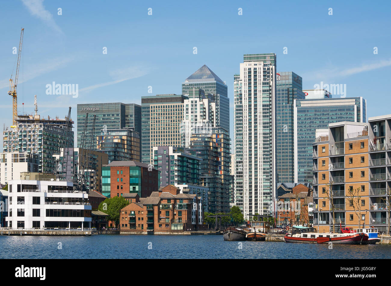 Buildings at Canary Wharf, Docklands, East London UK, from Millwall Dock - Stock Image
