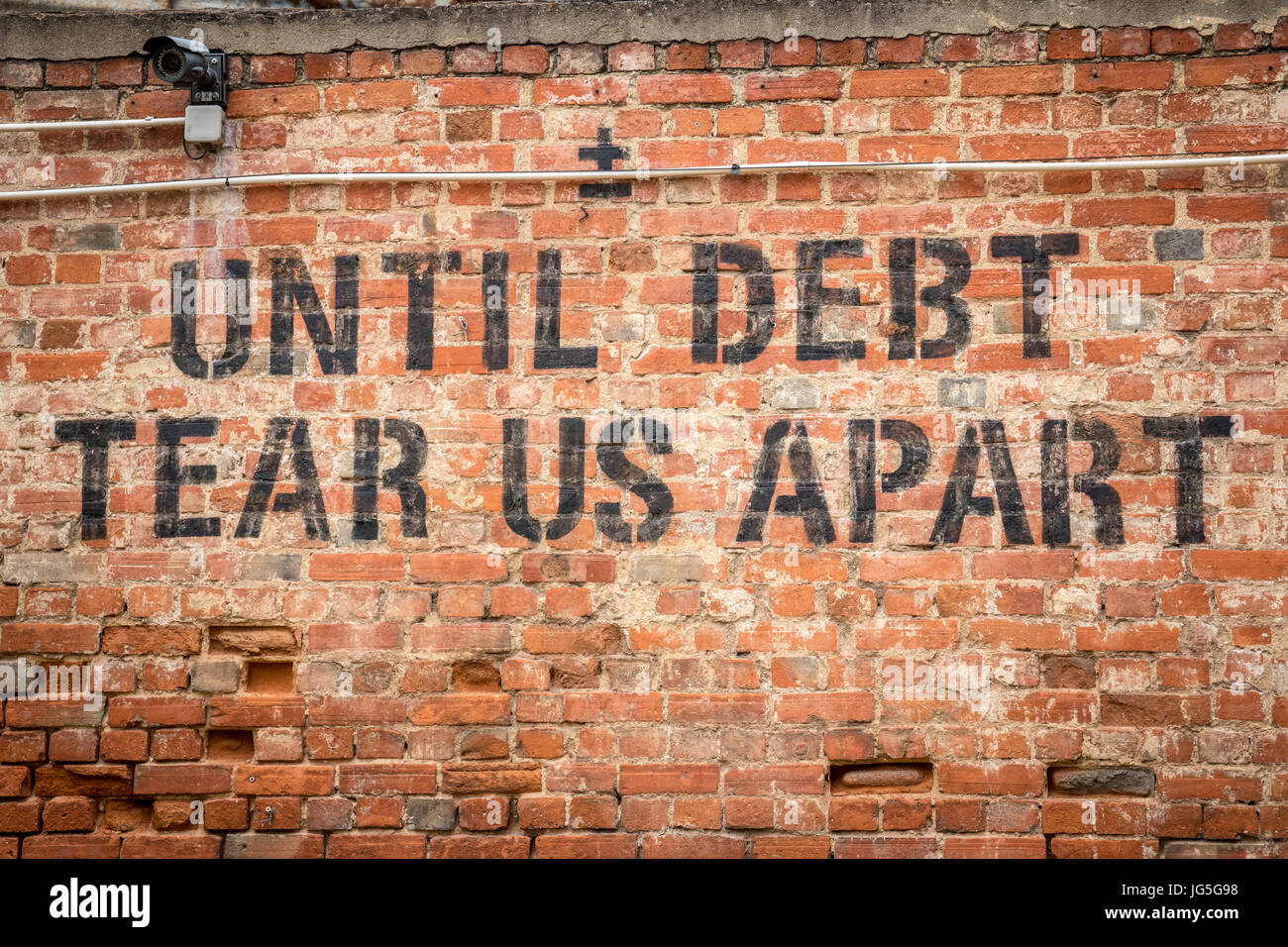 LISBON, PORTUGAL - June 2017 - Until debt tear us apart message on a wall in the LX factory area of Lisbon, Portugal - Stock Image