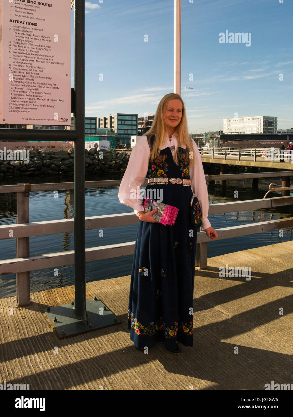 Young lady in Norwegian national dress welcoming visitors to Trondheim a city on Trondheim Fjord Norway Stock Photo