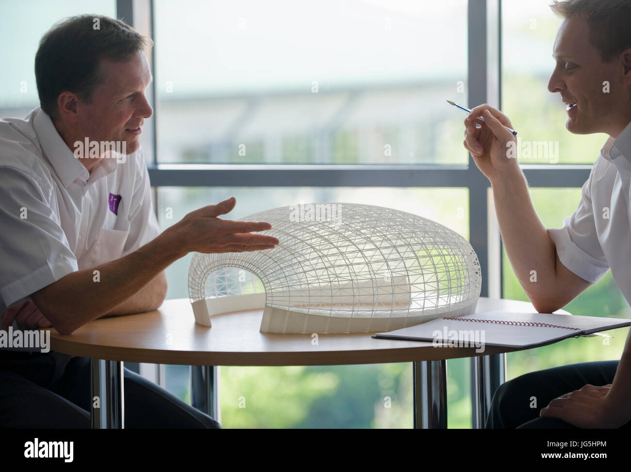Complex 3-dimensional object produced by Selective Laser Sintering (SLS) under discussion. - Stock Image