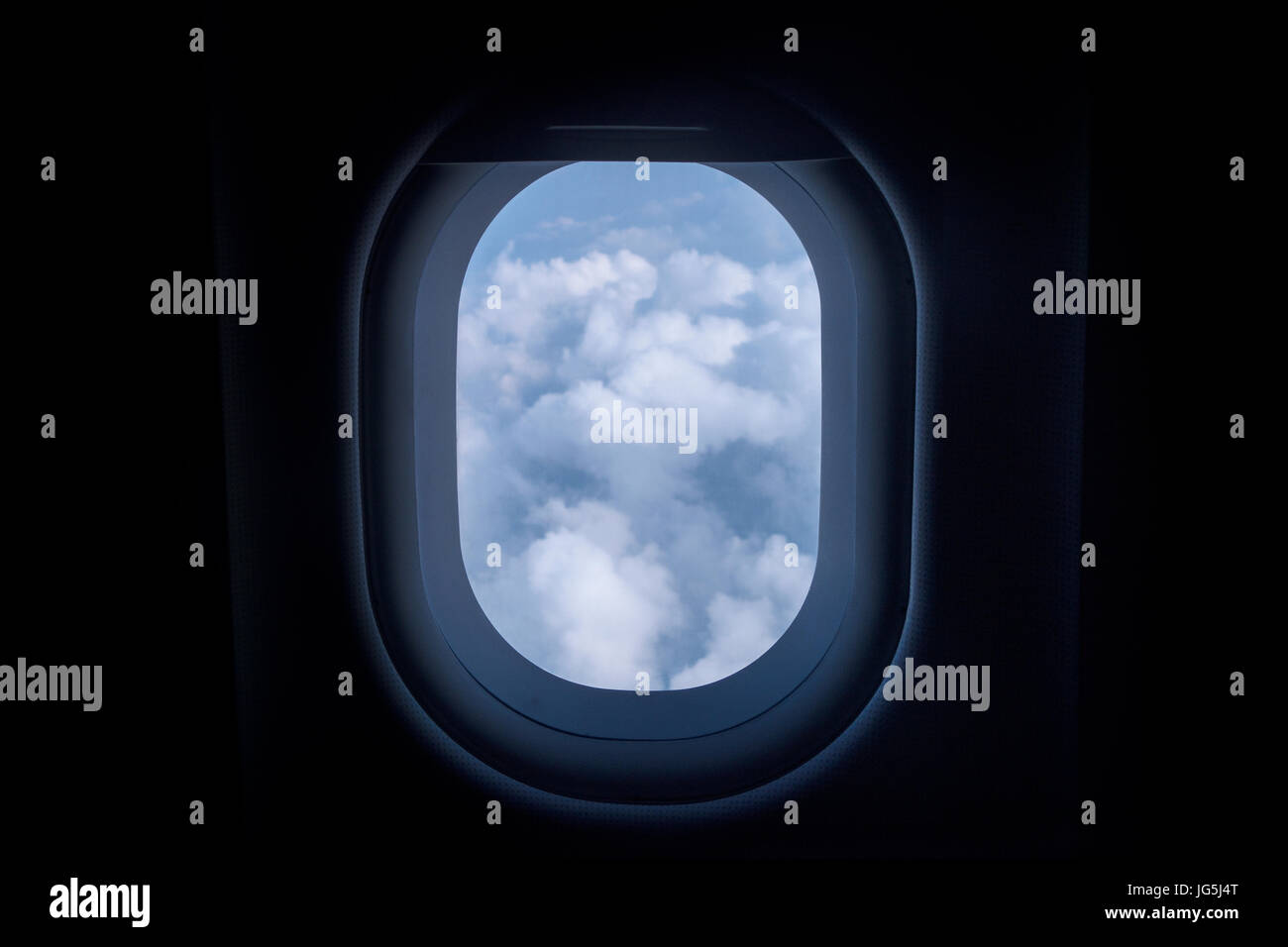 passenger airplane aircraft window blue sky and clouds Stock Photo