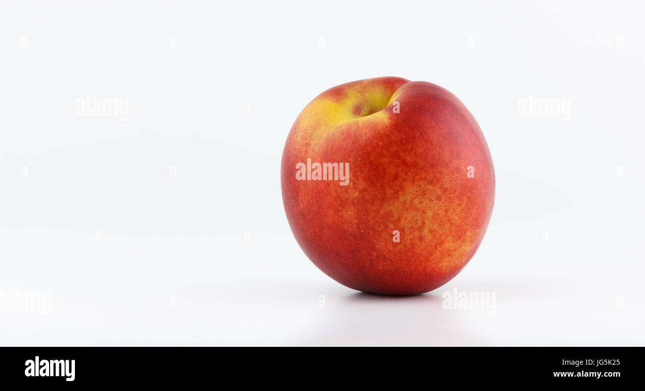 Freash healthy peach isolated on white background, vegan lifestyle - Stock Image