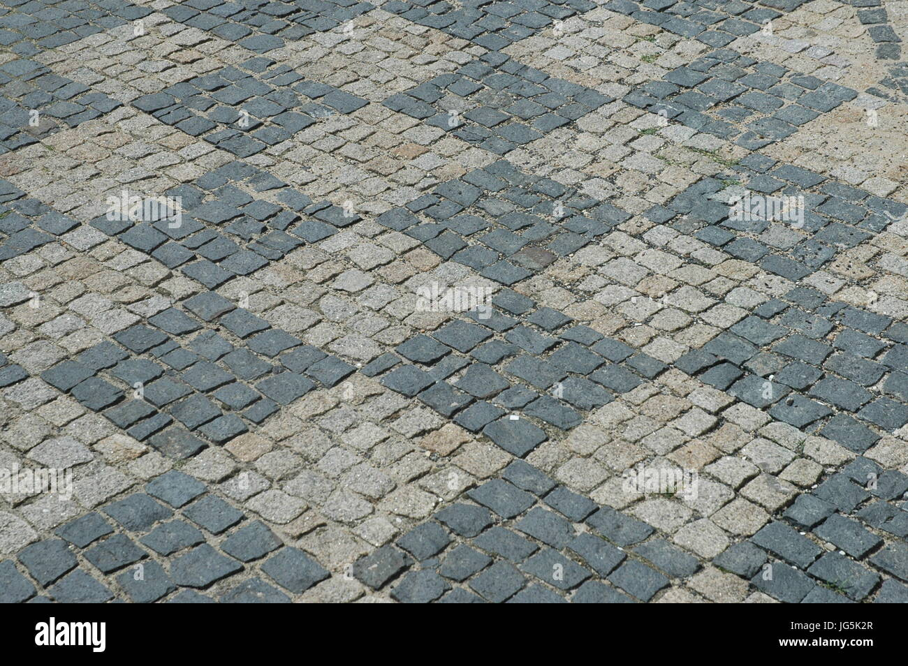 pavement with chequerboard pattern - Stock Image