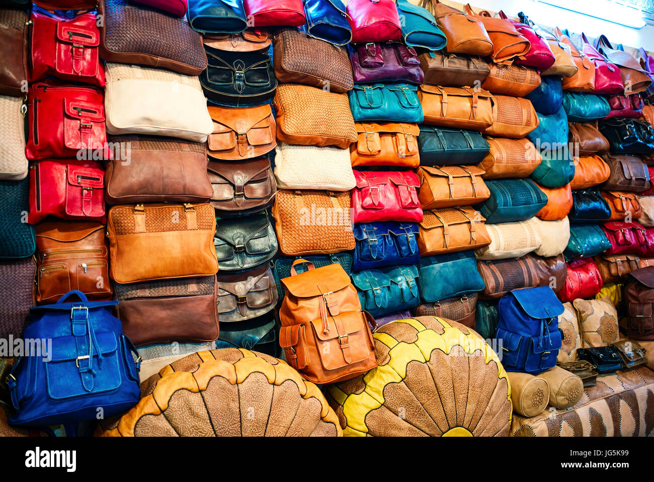 Selling leather goods in a shop in the medina of Fez, Morocco - Stock Image