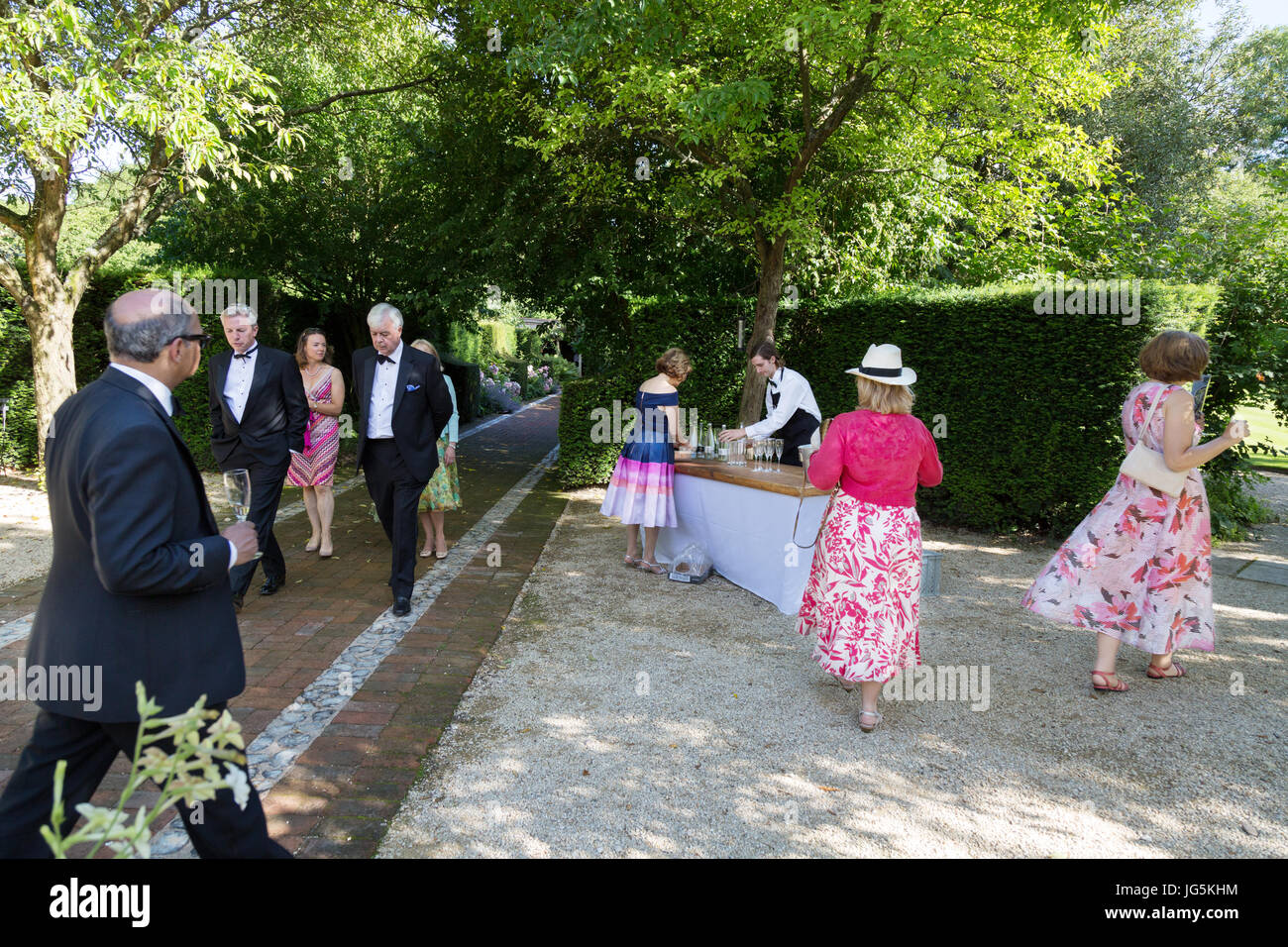 Garsington Opera - people looking at the gardens, Wormsley Park Estate, home of the Getty Family,  Stokenchurch, - Stock Image