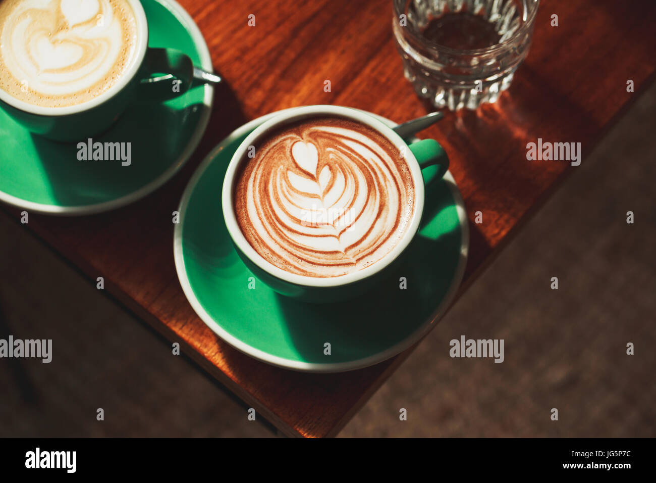 Cup of cappuccino with latte art - Stock Image