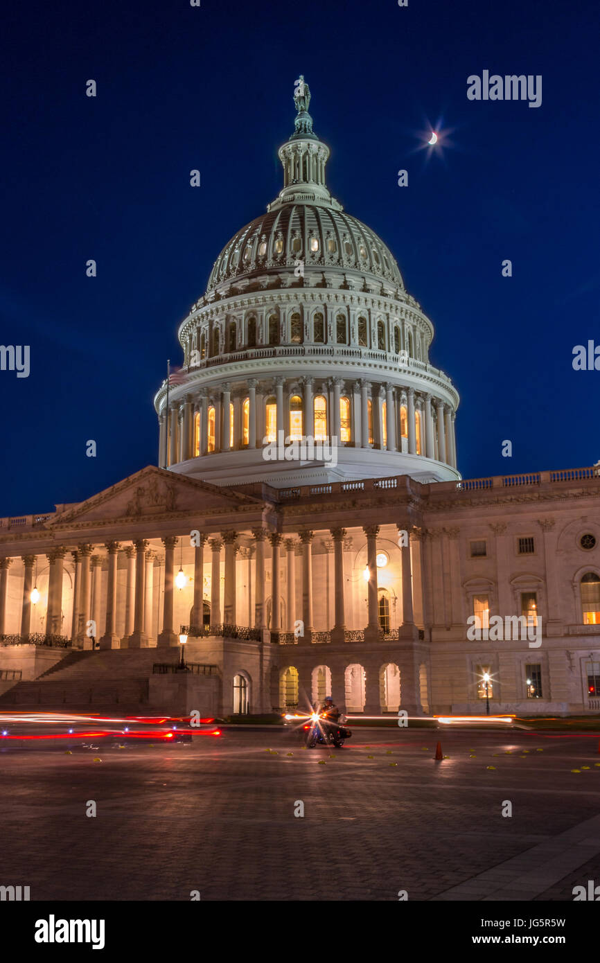 The US Capitol At Night With Moon Shining Up Above, Light Painting - Stock Image