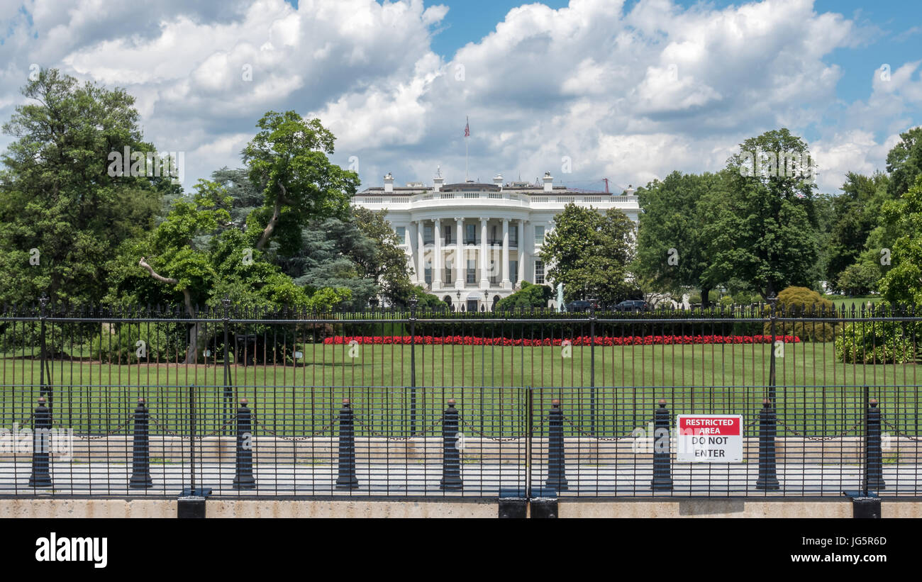 View of White House Behind Iron Fence - Stock Image