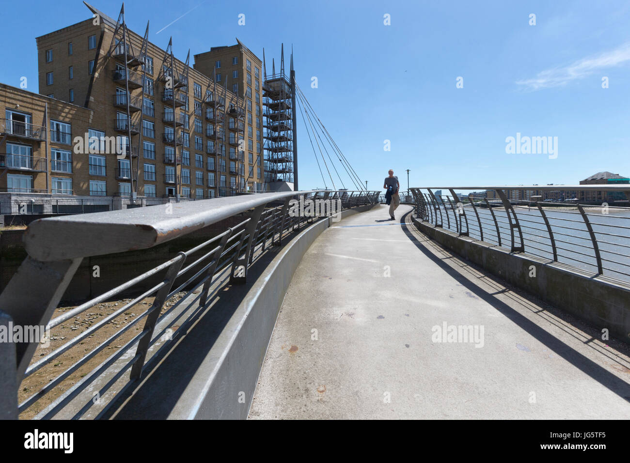 Pedestrian bridge over an inlet of the river Thames, Narrow Street, Limehouse, Tower Hamlets, London, UK - Stock Image