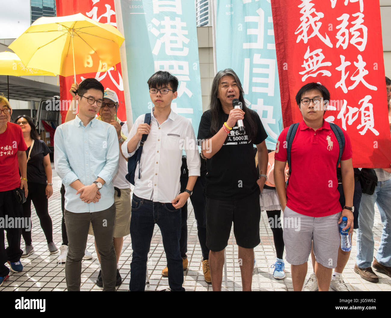 HONG KONG, CHINA - JULY 03: Joshua Wong Chi-fung (2nd left),the Hong Kong student activist and secretary general Stock Photo