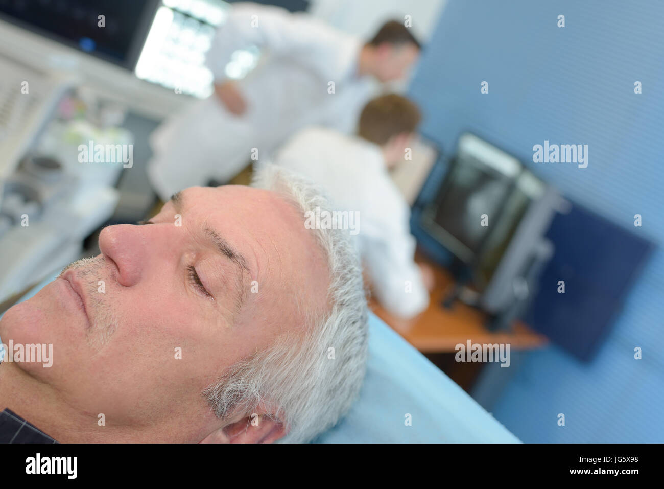 senior patient is anesthetized - Stock Image