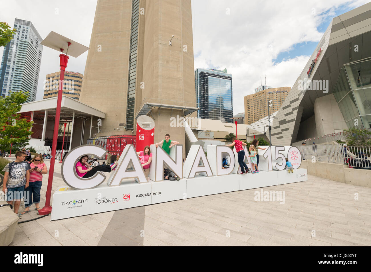 Toronto, Canada - 26 June 2017: Canada 150 sign at the bottom of CN tower - Stock Image