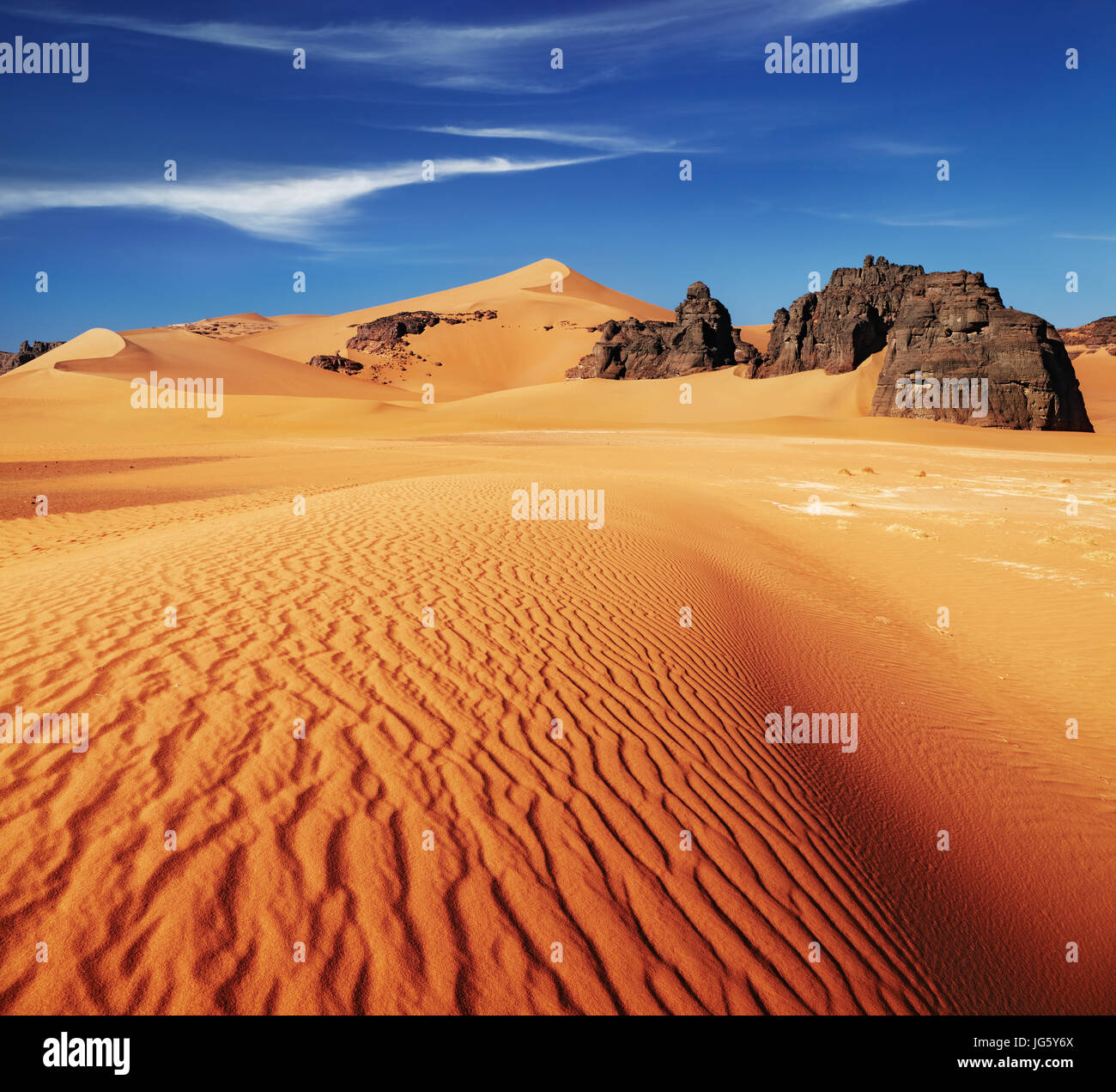 Sand dunes and rocks, Sahara Desert, Algeria - Stock Image