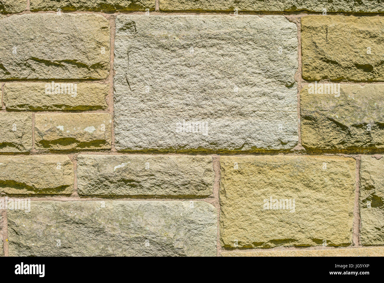 An outdoor sandstone wall adds a different charm to your exteriors and also makes it safe from intrusion by animals - Stock Image