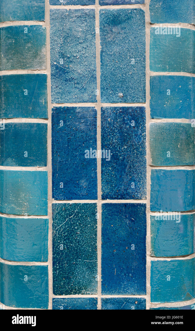 Blue ceramic tiles on a column in different shades including aqua ...