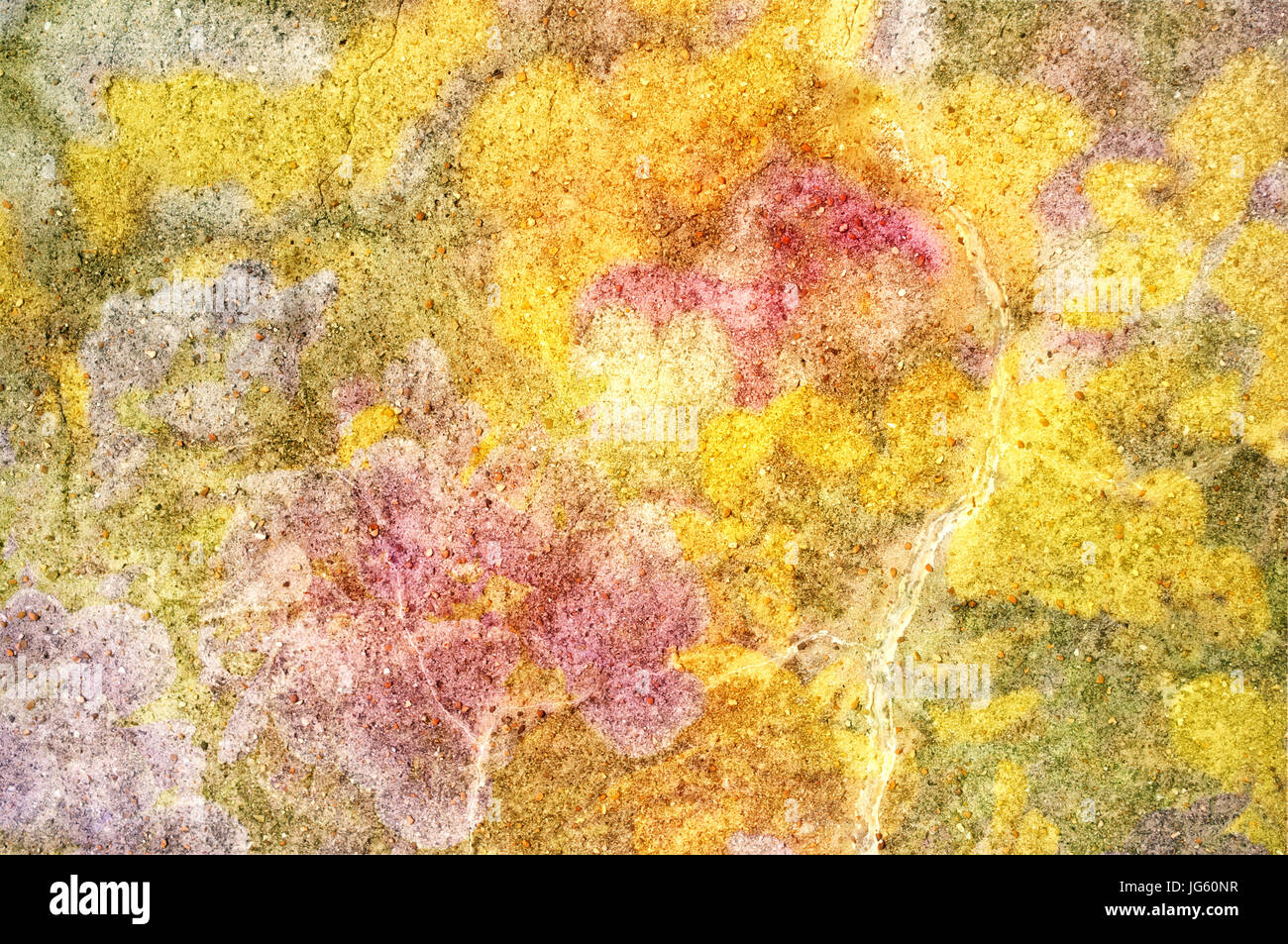 Abstract background texture of a piece of stone, scattered with smaller stones and overlaid with bright yellow, - Stock Image