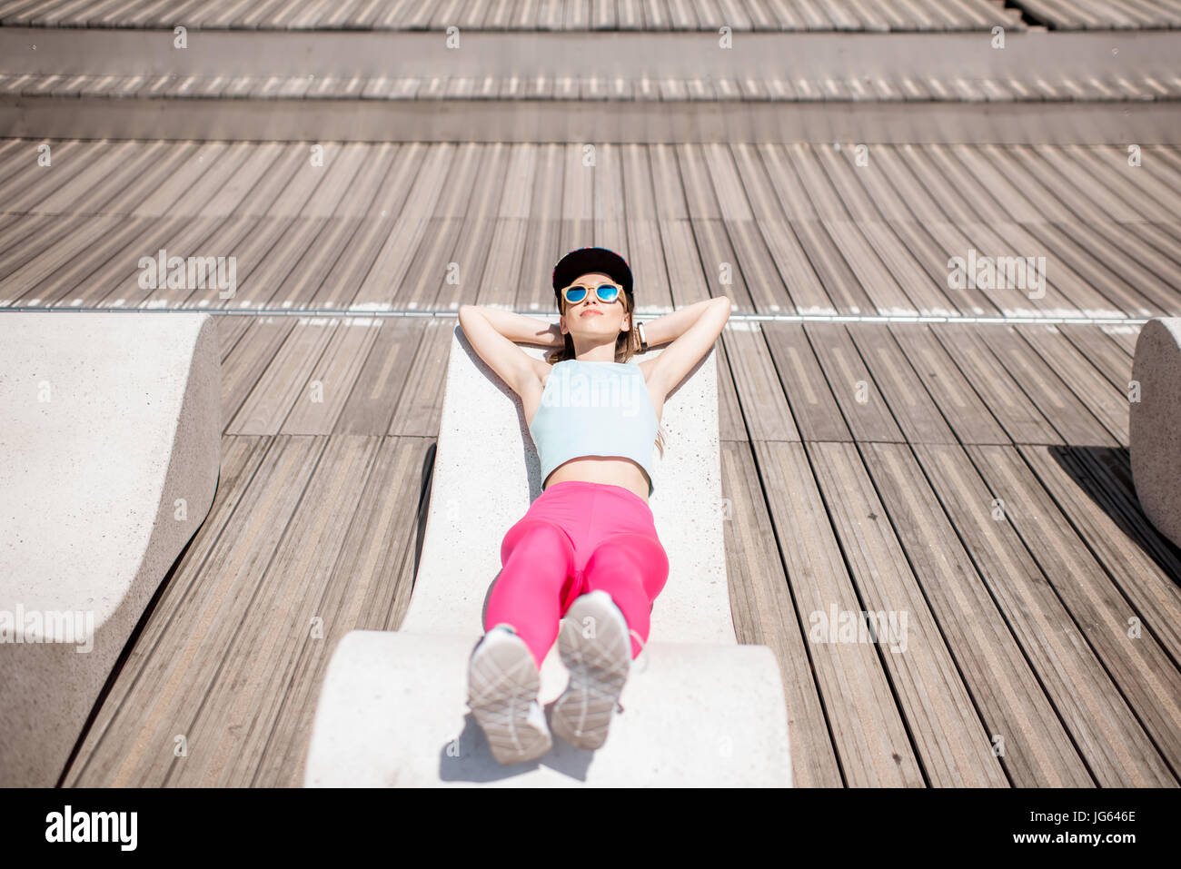 Woman in sportswear on the sunbed - Stock Image
