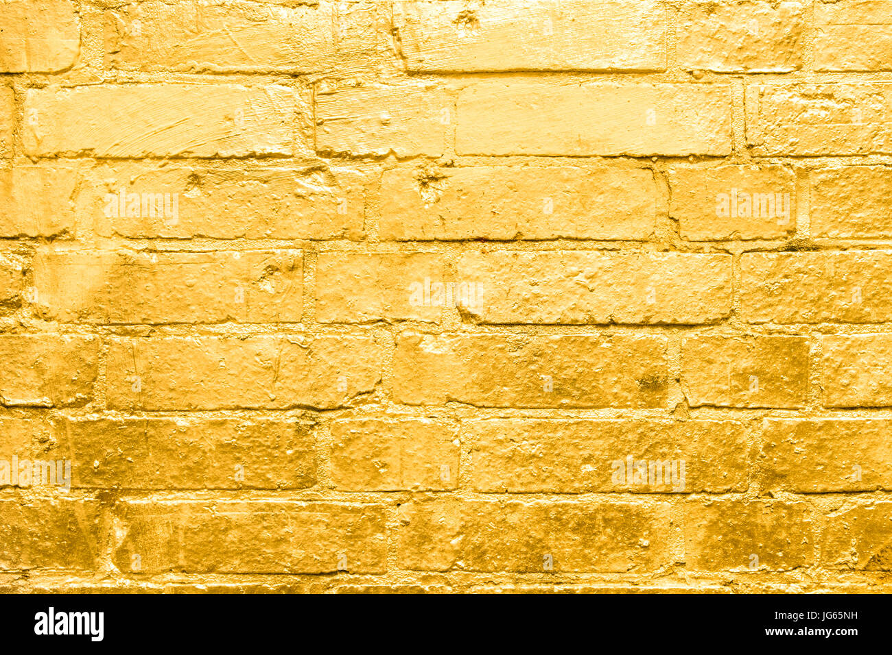 brick wall painted in gold - golden graffiti background Stock Photo ...