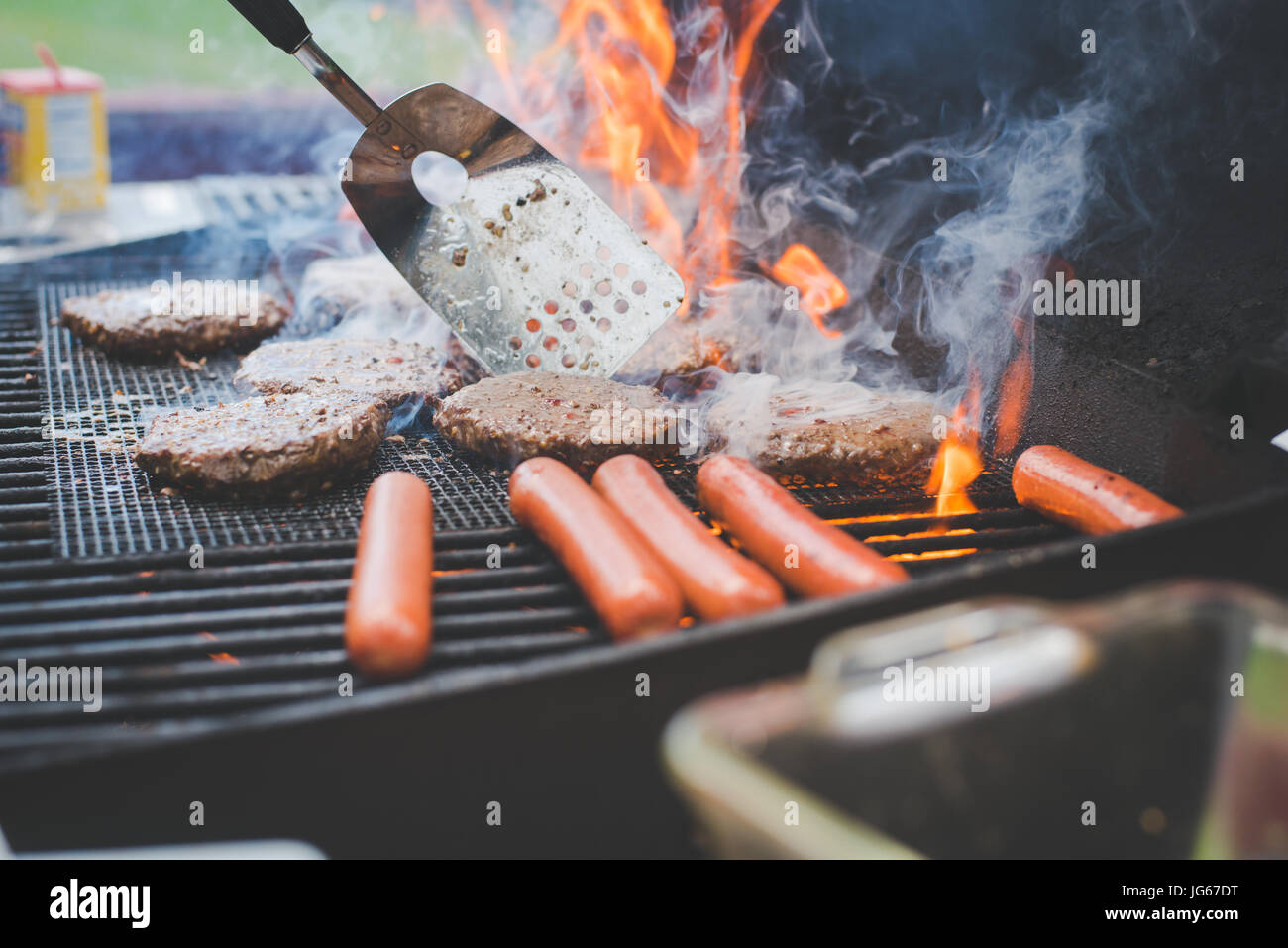 Food cooks on a grill in summer - Stock Image