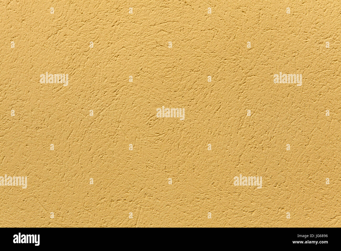 Yellow ochre painted stucco wall  Background texture Stock Photo
