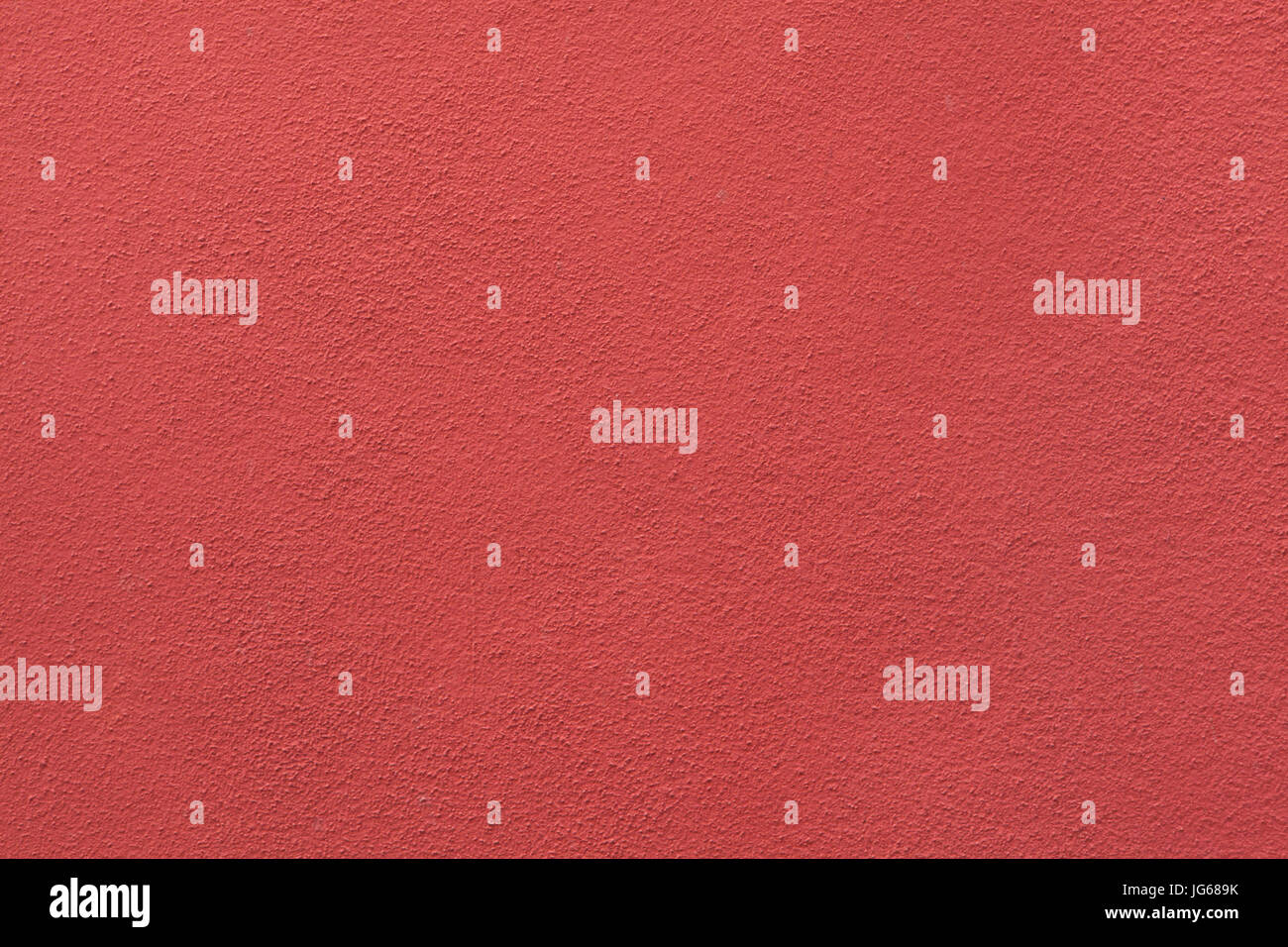 Red painted stucco wall. Background texture. Stock Photo