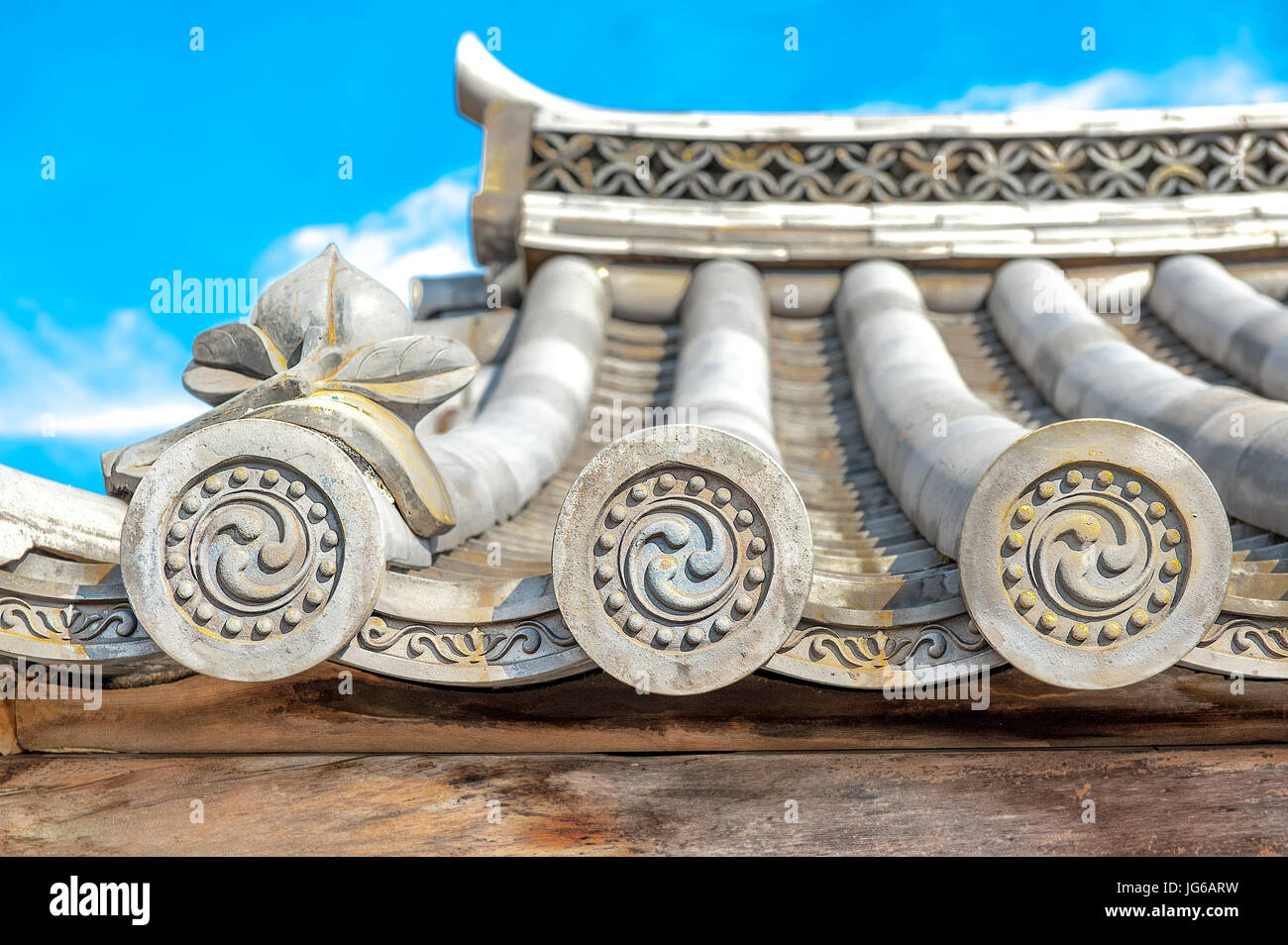 Ornate design end pieces of roof tiles which are for protective and decorative purposes, also known as 'WADANG' Stock Photo