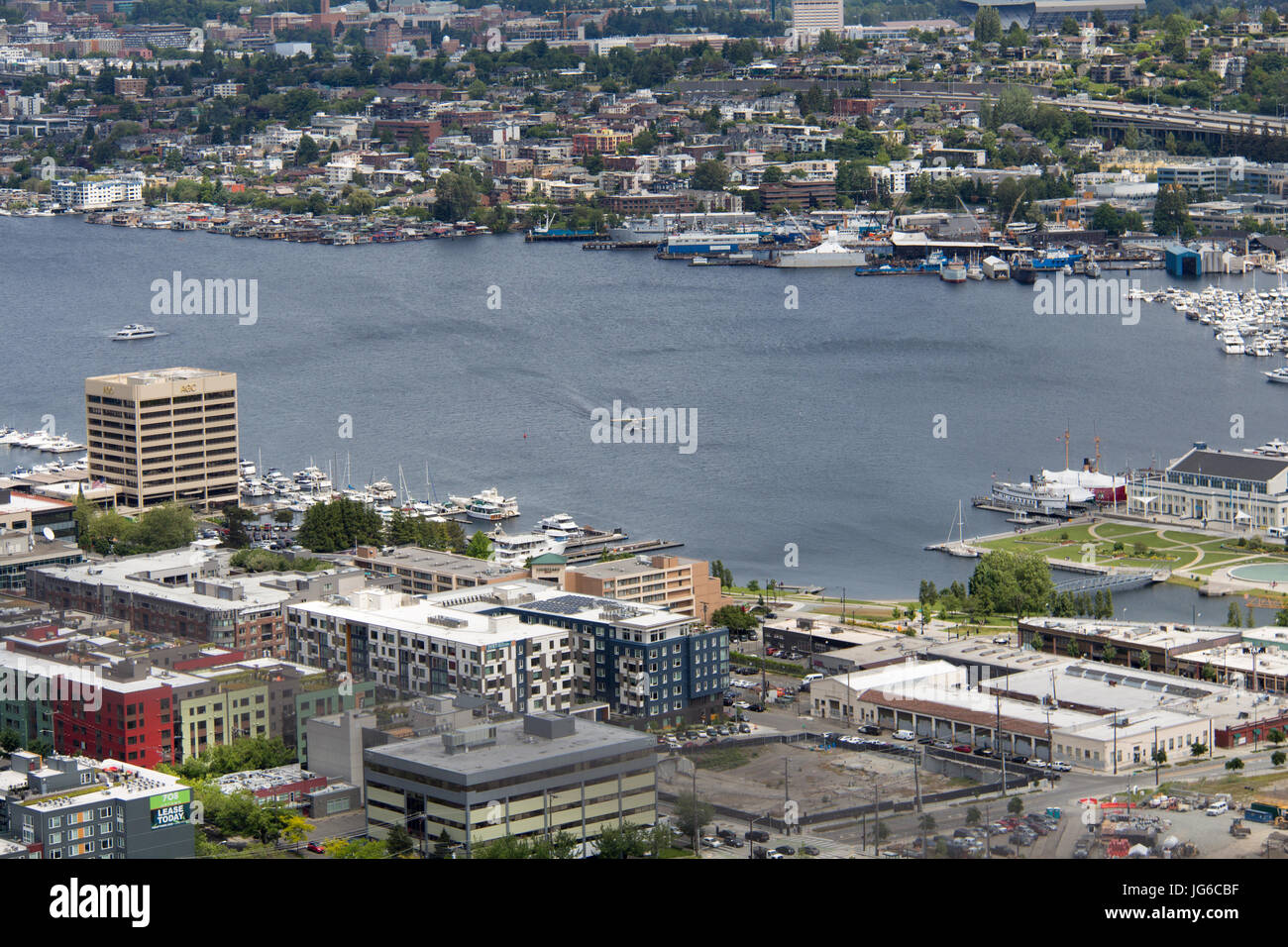 View on Lake Union from the Space Needle in Seattle, Washington with a seaplane landing on the water - Stock Image