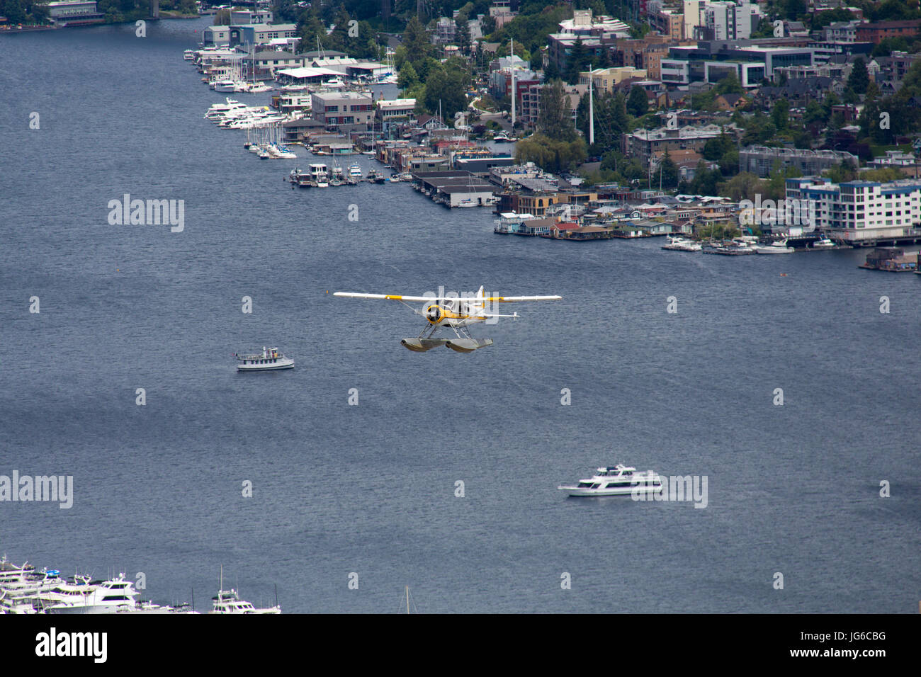Seaplane is taking off from Lake Union in Seattle, Washington - Stock Image