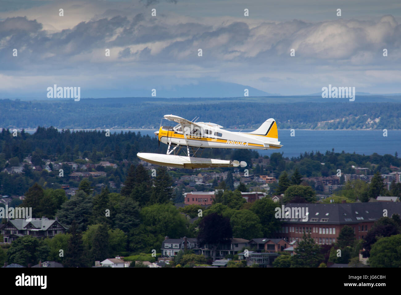 Seaplane from Kenmore Air during a scenic flight in Seattle, as seen from the Space Needle in Seattle, Washington - Stock Image