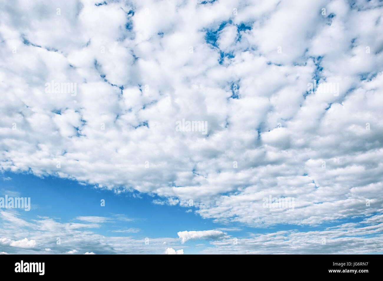 White fluffy clouds background. The horizontal frame. - Stock Image