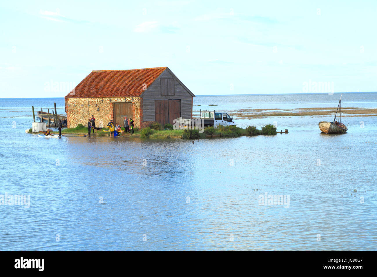 cut off by high tide, van, truck, people, North Sea surge, Coal Barn, Thornham, Norfolk, England, UK. tides, tidal, - Stock Image