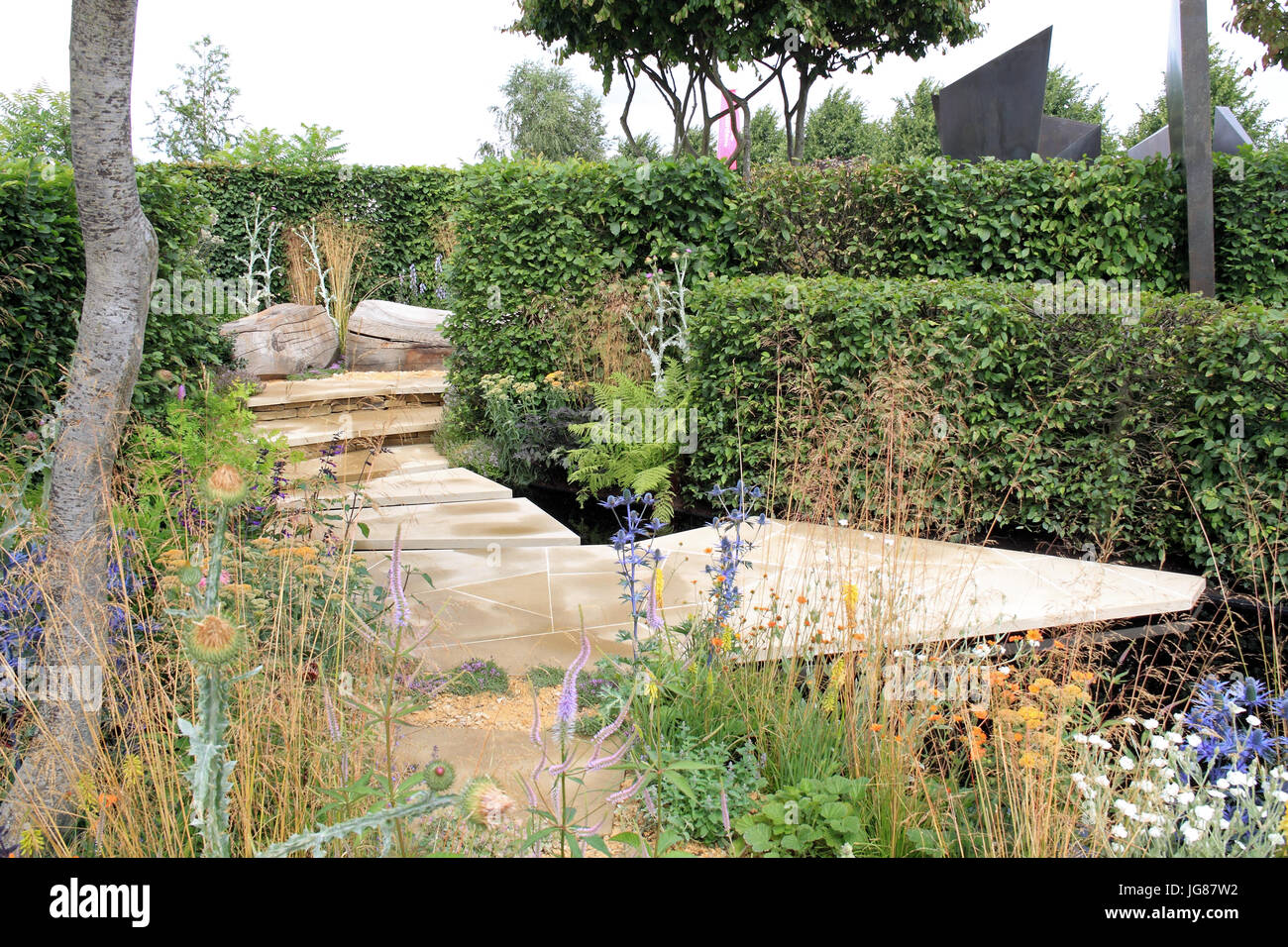 RHS 'Watch This Space', designed Andy Sturgeon. Show Garden. RHS Hampton Court Palace Flower Show, London, England, Stock Photo