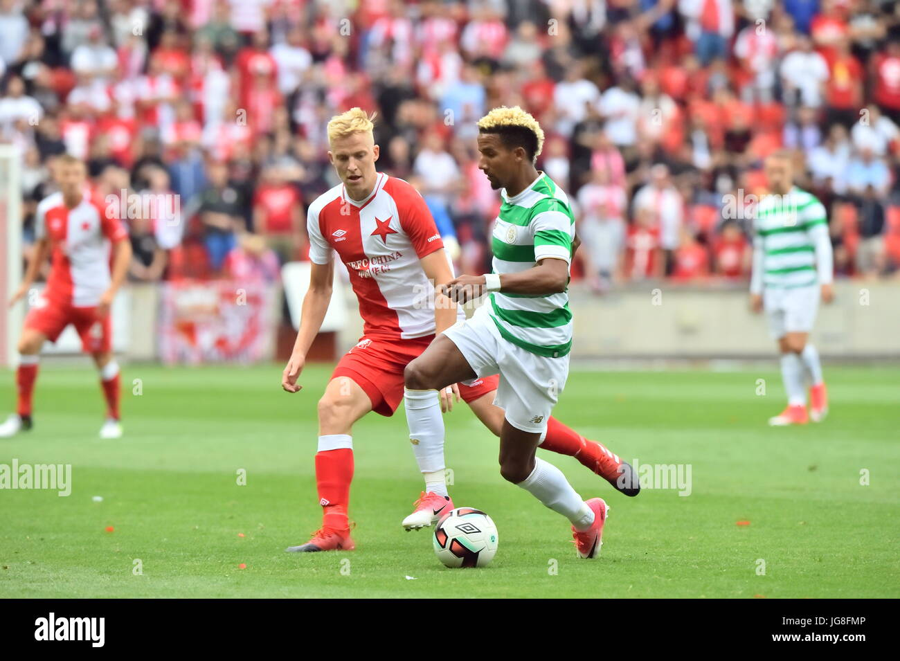 Prague, Czech Republic. 4th July, 2017. Michal Frydrych of Slavia, left, and Scott Sinclair of Celtic in action - Stock Image